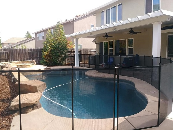 black mesh pool fence installed in Lincoln, CA