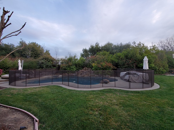 brown mesh pool fence installed in Lafayette, CA