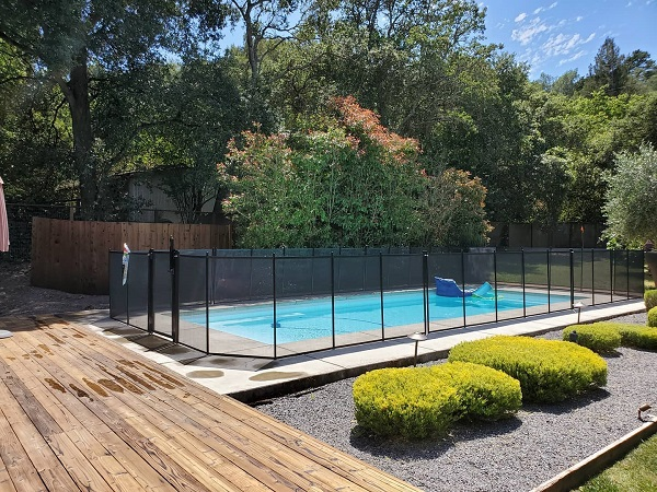 black mesh pool fence with self-locking gate installed in Santa Rosa, CA