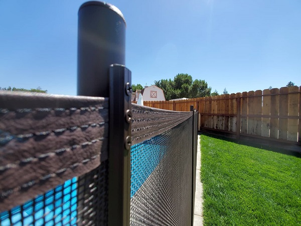 brown mesh pool fence installed in Atwater, CA