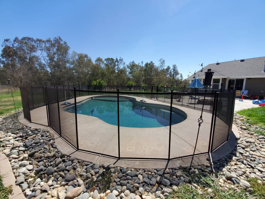 removable mesh pool fence installation in Herald, CA