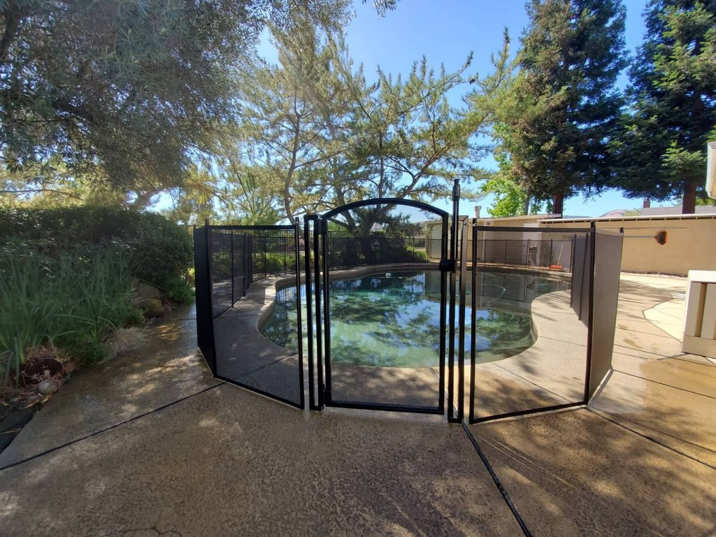 brown mesh pool fence installed with self-closing pool gate in San Ramon CA