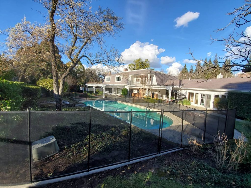 black mesh pool fence installed with pool gate in Castlewood, CA