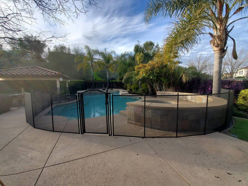 mesh pool fence installed around inground pool
